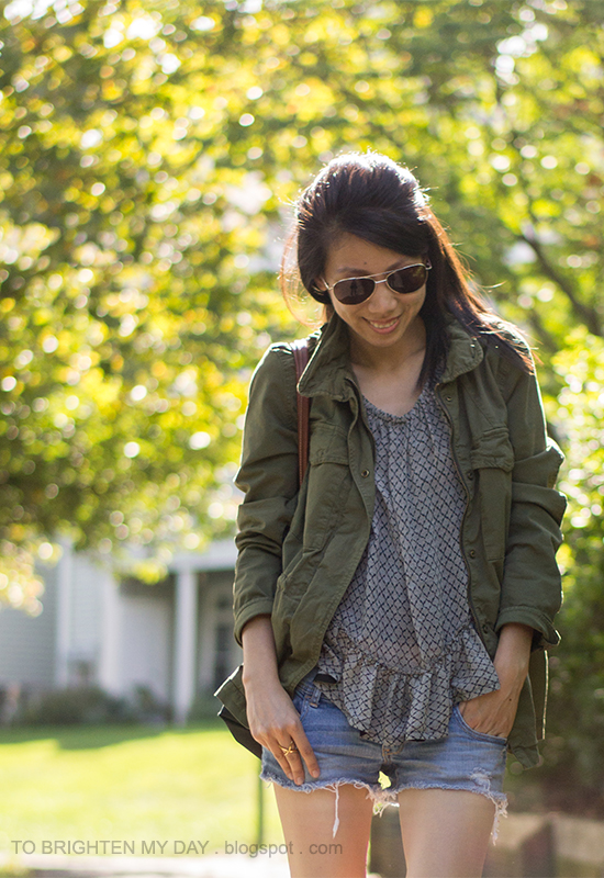military jacket, ruffled blouse, distressed shorts