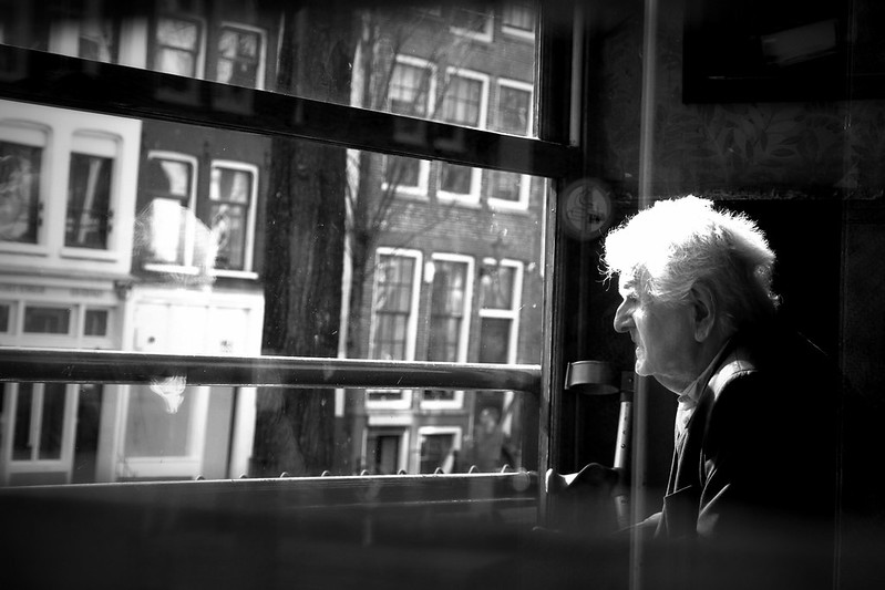Another black and with photo with an old man in a window