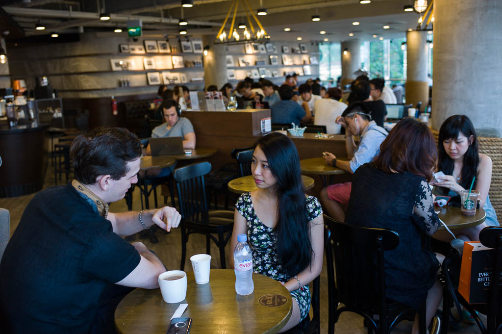 A couple chilling out on a Sunday afternoon at Starbucks' 100th store in Singapore