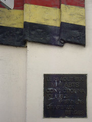 Photo of The Belgian flag and Marie Abts-Ermens black plaque