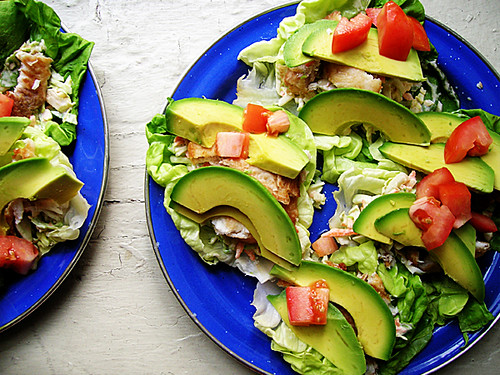 fish tacos with brussels slaw, avocado, and tomato