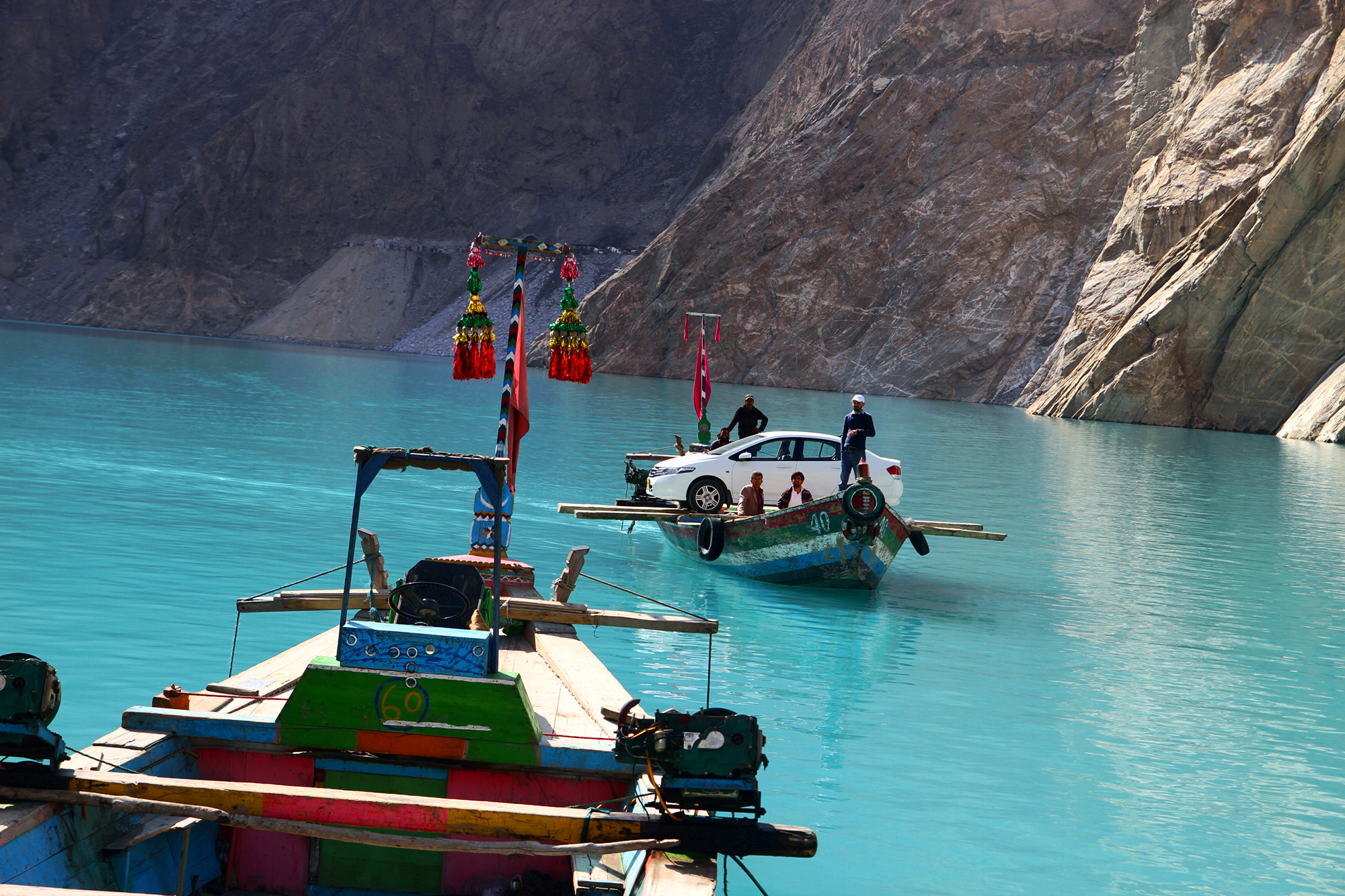 An improvised ferry in Attabad Lake, Northern Pakistan | By Asad Munir [2000x1333]