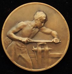 Young Man Filing medal by Alexandre Charpentier