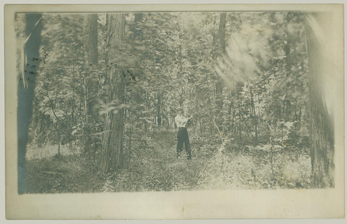 Man in forest.
