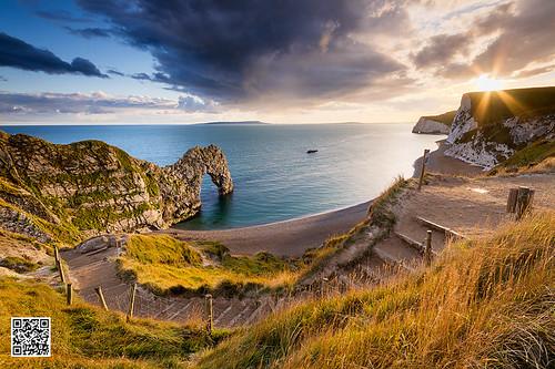 sunset coast steps dorset sunburst rays lulworth durdledoor limestonearch