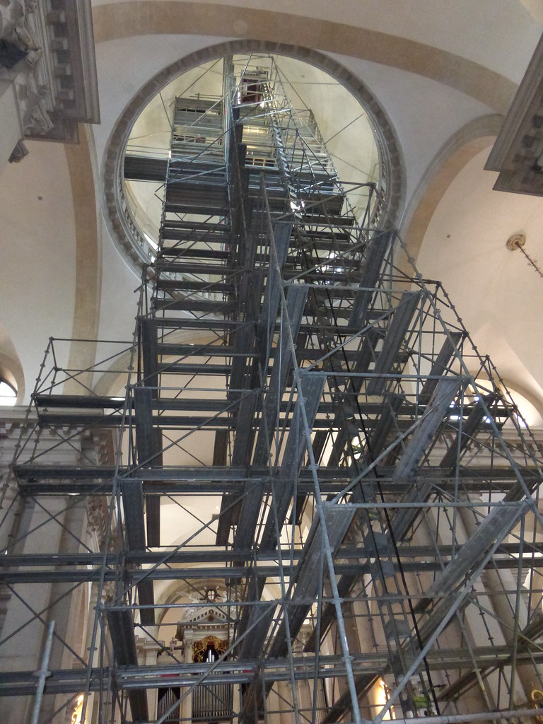 Scaffolding reaches high into the dome