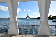 The USS Missouri, on which the armistice ending World War II was signed, as seen from the memorial to the USS Arizona, which was sunk in the Pearl Harbor attack drawing the United States into the war, as seen during a visit by U.S. Secretary of State John Kerry to Pearl Harbor, Hawaii, on August 13, 2014, after the two laid a wreath at the famed World War II site. It followed a regional military briefing coming at the conclusion of an around the world trip that included stops in Burma, Australia, and the Solomon Islands. [State Department photo/ Public Domain]