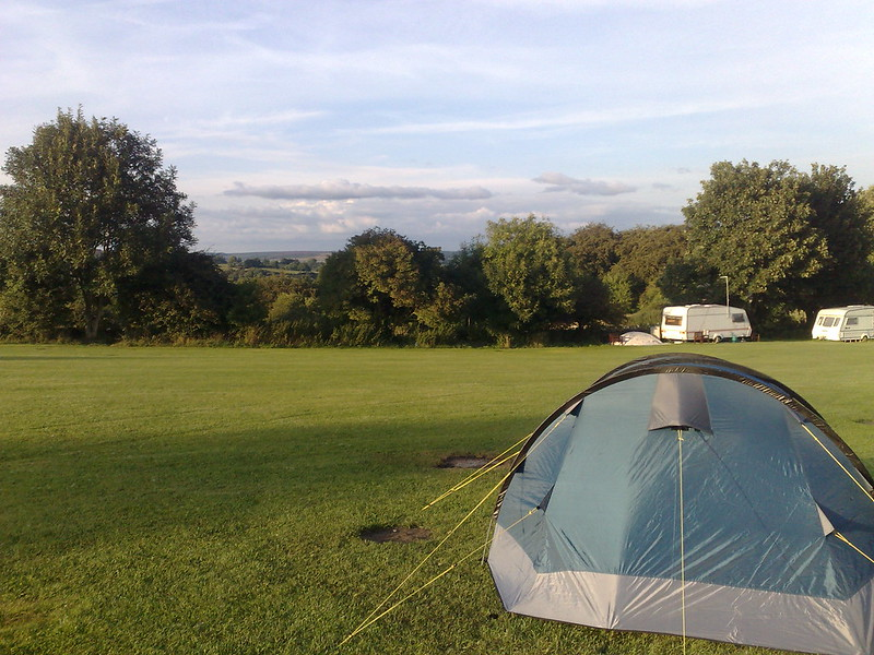Tent pitched, with a view over the surrounding countryside