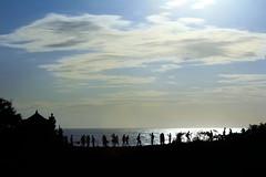 Silhouettes against the sea