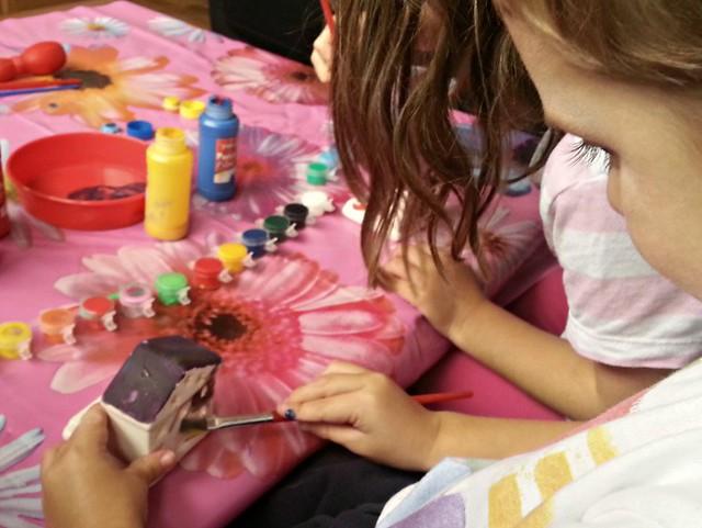Painting Baker Ross Tea Light Holders, children get messy