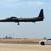 A mobile chase car pursues a U-2 Dragon Lady as the aircraft prepares to land June 16, 2015, at Beale Air Force Base, California. Mobile chase cars guide the aircraft during takeoffs and landings. (U.S. Air Force photo by Airman 1st Class Ramon A. Adelan/Released)