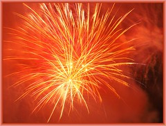 Sparkling Yellow and Orange Fireworks in Reddish Orange Smoke and Frame