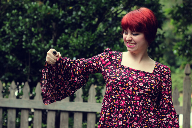 Square Neckline Bell Sleeve Floral Dress, Black Vintage Ring, and a Red Pixie Cut