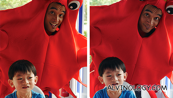 Asher taking picture with the lobster mascot at Crab in Da Bag