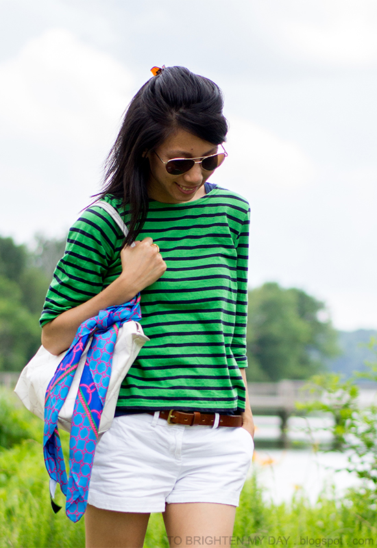 green/navy striped top, white shorts, blue scarf + white tote