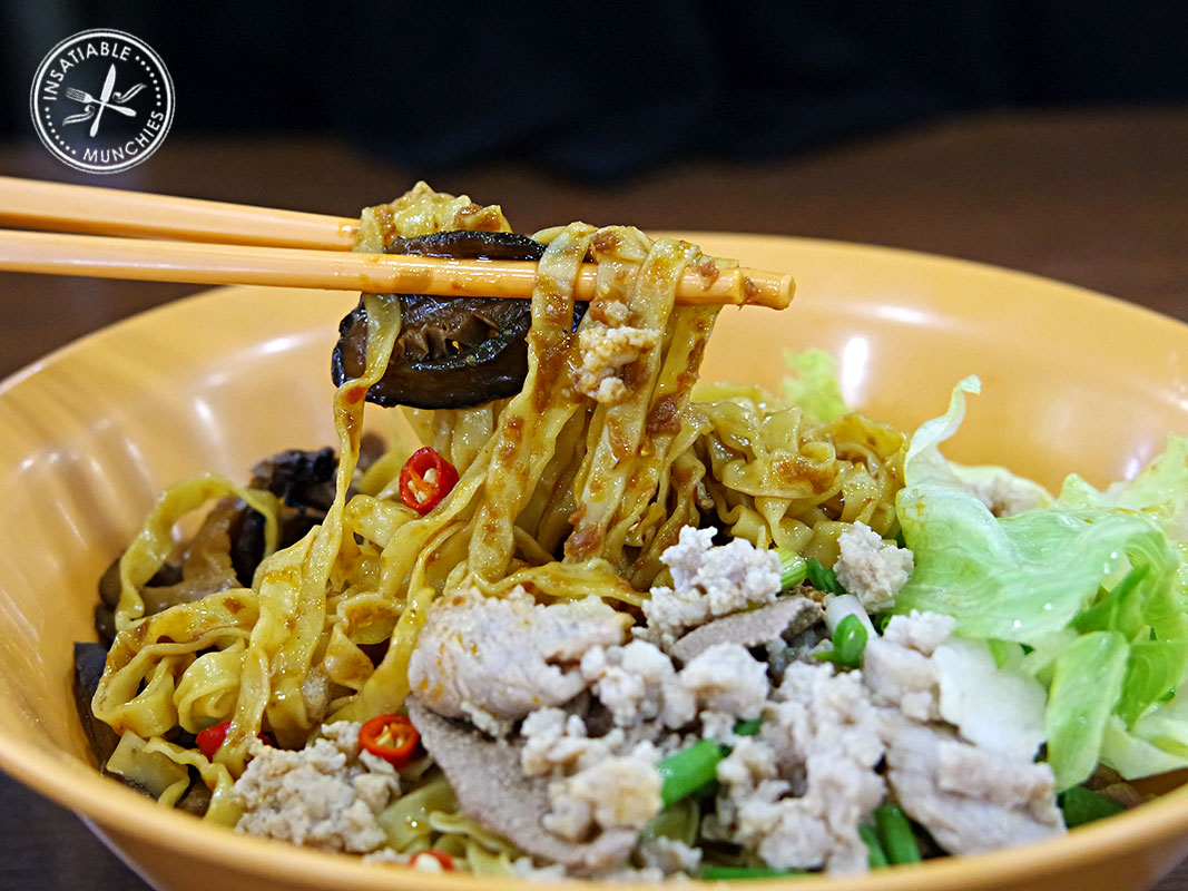 Egg noodles are tossed in with a house made chilli sauce, cooked pork mince, braised mushrooms and a lashing of vinegar.
