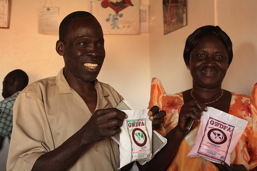 Gulu Dairy workers hold yogurt