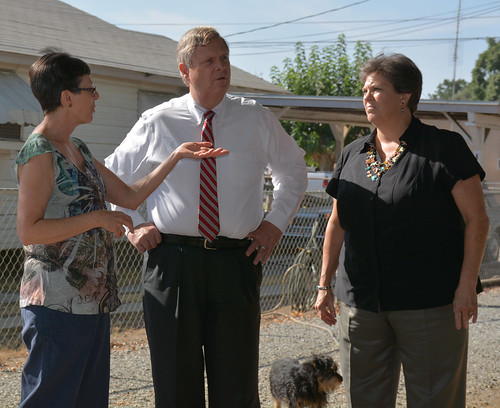 Carlen Overby (left), with Agriculture Secretary Tom Vilsack and Rural Development State Director Glenda Humiston, shares some of the struggles she and her neighbors in Cameron Creek Colony face since their wells have gone dry.