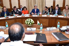 U.S. Secretary of State John Kerry, center, U.S. Commerce Secretary Penny Pritzker, left, and U.S. Assistant Secretary of State for South and Central Asian Affairs Nisha Desai Biswal, right, sit across from Indian Minister of Finance and Defense Arun Jaitley in New Delhi, India, at the outset of a meeting as part of a Strategic & Economic Dialogue between the two countries on July 31, 2014. [State Department photo/ Public Domain]