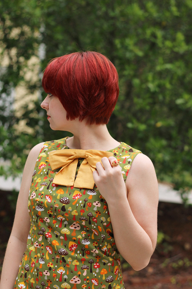 Green Mushroom Print Dress with a Yellow Bow and Short Red Hair