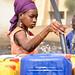 Jeune fille à la Corvee d'eau, pres de Mbane, Region de Saint Louis, Senegal by simone_frattini