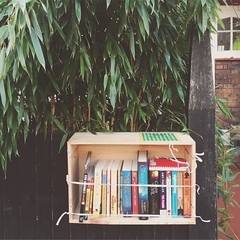 I've wanted to do this for ages, I love book swapping. So I've set up my own little free library in a wine box and hung it from my front fence. Take a book, leave a book, write us a message about books.