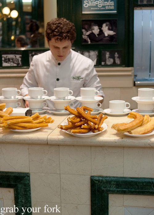 Thin churros donuts and thicker porras donuts at Chocolateria San Gines in Madrid, Spain