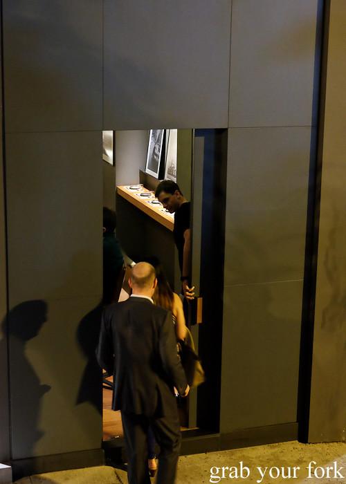 Diners entering the secret doorway at Ronin, Hong Kong
