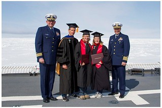 Stanford University graduates, Erin Dillon and Caroline Ferguson, stand as part of the official party with from left to right): Cmdr. Gregory Stanclik, Healy's executive officer; Dr. Kevin Arrigo, Donald and Donald M. Steele professor of Earth Sciences; Erin Dillon, graduate; Caroline Ferguson, graduate; and Capt. John Reeves, Healy's commanding officer. The Coast Guard Cutter Healy and members from Stanford University who are aboard the cutter conducted a graduation ceremony above the Arctic Circle June 10, 2014, to confer undergraduate degrees for two students who were unable to participate in the university's 123rd commencement exercises in Palo Alto, Calif. (Photo courtesy Carolina Nobre.)