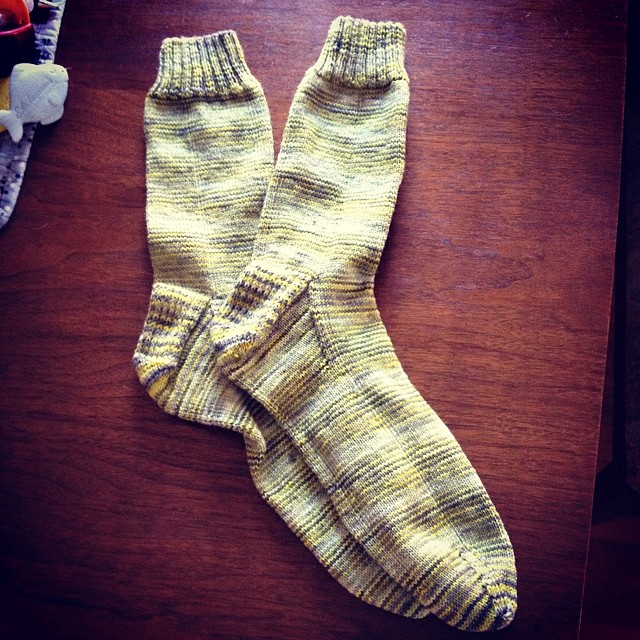 "Handknit socks for my husband for Father's Day. Because nothing says ""I love and appreciate you"" more than large guy socks knit on size 1 needles. #operationsockdrawer #knitting #destinationyarn #socks #summerofsocks"