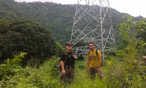 My hiking buddy Siopao and I near one of the power line towers along Mt Babag