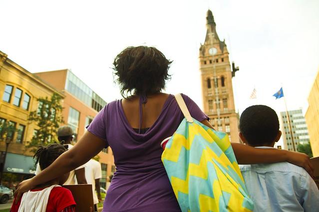 Family Marches Towards City Hall