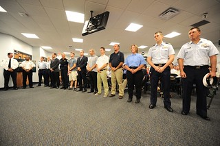 Representatives from multiple agencies and companies receive a Coast Guard Meritorious Team Commendation Thursday, Aug. 28, 2014, during a presentation at the Port Canaveral Port Authority Maritime Center in Port Canaveral, Fla. The award was presented to the representatives for their organizations' cooperation in a rescue operation in July, involving 19 ill crew members aboard the bulk carrier J.S. Comet during a tropical storm. (U.S. Coast Guard photo by Petty Officer 2nd Class Anthony L. Soto)