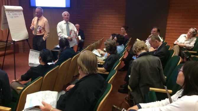 Members of the public watch as VTA staff lead a discussion about the North/South Bus Study at Sunnyvale City Hall on Sept 9, 2014