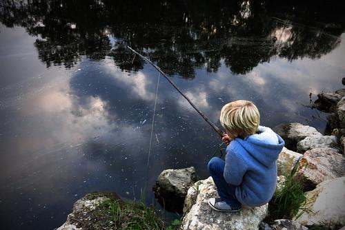 little boy fishing the sky