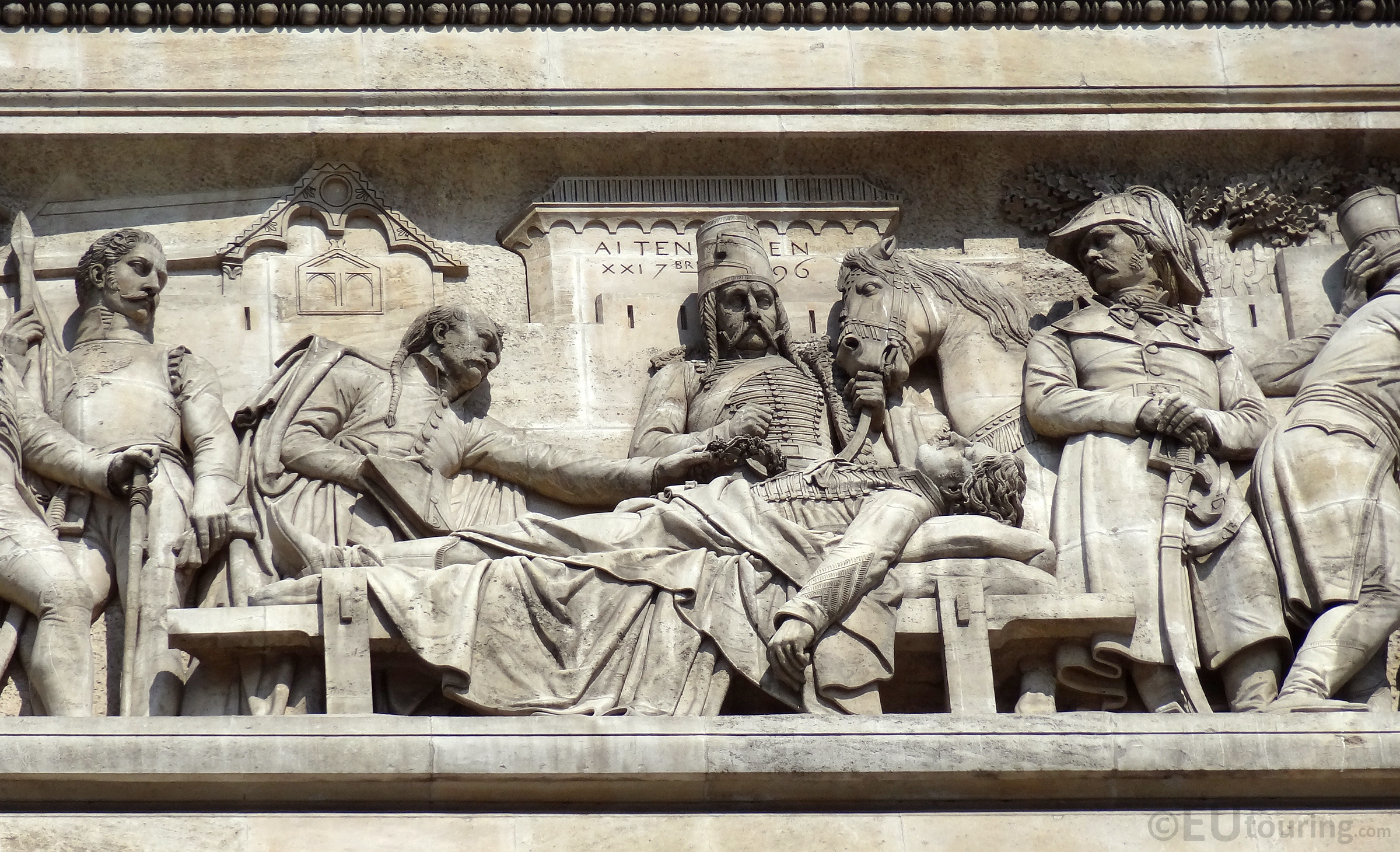 Stone historic scene at the Arc de Triomphe