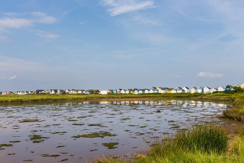 Beach huts reflected