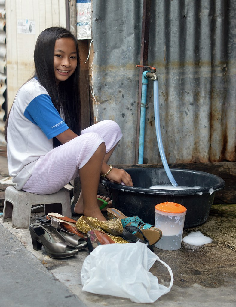 pre-teen nude pretty preteen girl washing shoes
