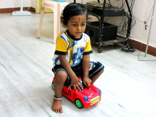 Nephew riding on his car :)