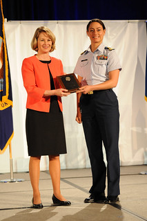 Lt. Karen Appel, budget officer of the 13th Coast Guard District, receives the Meritorious Award with the American Society of Military Comptrollers Awards Program in the Accounting and Finance category from Marilyn Thomas, president of the ASMC, during the 2014 Professional Development Institute at the Washington State Convention Center in Seattle, May 28, 2014. Appel received the award for streamlining the process of accounting for Coast Guard property and operating expenses. U.S. Coast Guard photo by Petty Officer 3rd Class Katelyn Shearer.