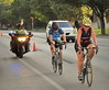 Mayor Betsy Price rides through Fort Worth's near south side during the Mayor's Triathlon on Sunday, July 13, 2014