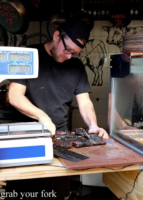 Drink 'n' Dine group chef Jamie Thomas carving meat at the Oxford Tavern, Petersham