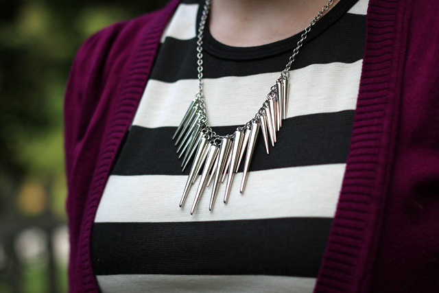 Silver Spiked Necklace with a Striped Dress and Purple Cardigan