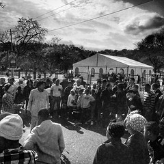 A crowd surrounding an informal performer at the Women's Day celebrations at the Union Buildings. #womensday #people #street #crowd #unionbuildings