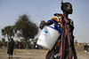 A woman holds a UNICEF donated bucket during a rapid response mission (RRM) in the village of Rubkuai. In February 2017, the UN declared famine in two counties of South Sudan where 100 000 people are facing famine and one million are on the brink of starvation.   Photo: UNICEF/Siegfried Modola