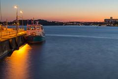Storholmen at dock against setting sun