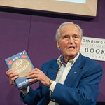 Nicholas Parsons with his new book about the legendary BBC Radio 4 show Just a Minute |