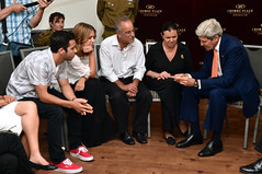U.S. Secretary of State John Kerry relays a medal given to him by Israeli President Shimon Peres to the Steinberg family of California - parents Stewart and Evie, and siblings Jake and Paige - before a shiva ceremony in Jerusalem on July 23, 2014, in honor of their son and brother Max, who was an American citizen killed while fighting for the Israeli Defense Force against Hamas in the Gaza Strip. [State Department photo/ Public Domain]