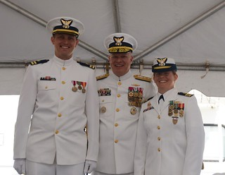 Lt. Joshua Zike, Rear Adm. Fred M. Midgette and Lt. Cmdr. Molly Waters pose for a photo during the Coast Guard Cutter Neah Bay change-of-command ceremony held at the cutter's  homeport of Cleveland, July 25, 2014.   Midgette, the Coast Guard 9th District's commander, presided over the ceremony where Zike relieved Waters as commanding officer of the cutter.  U.S. Coast Guard photo by Petty Officer 3rd Class Lauren Laughlin