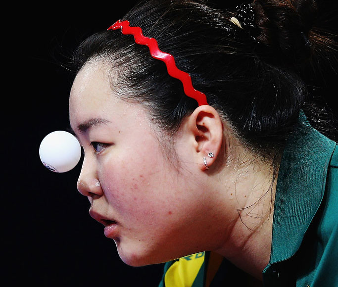 A Woman Staring At A Ping Pong Ball